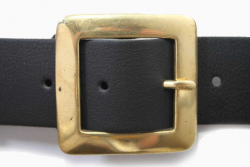 Vegan belt with a flat square brass buckle on a one and a half inch wide microfibre strap