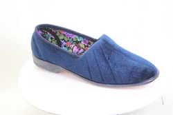 Blue slipper with a comfortable slightly soft footbed and foam rubber sole, under a velour top.